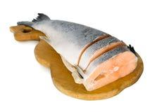 Salmon on cutting board Stock Photo