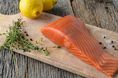 Salmon on a Cutting Board Stock Photography