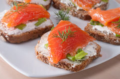 Salmon. Delicious canape with smoked salmon stock image
