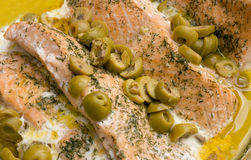 Salmon With Dill And Olives. Salmon with dill weed and anchovy olives in a bed of butter Royalty Free Stock Photography