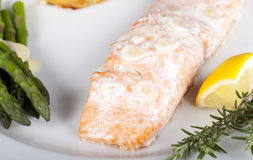 Salmon Dinner. Healthy dinner with baked salmon and asparagus Royalty Free Stock Images
