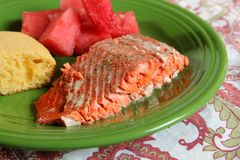 Salmon dinner. A salmon dinner with watermelon and cornbread as sides Royalty Free Stock Photo