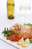 Salmon Dinner. A baked salmon dinner with vegetables and potatoes and a glass of wine Stock Images