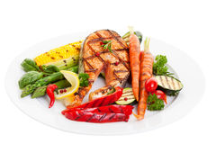 Salmon Dinner. Grilled salmon steak with vegetables corn and asparagus Royalty Free Stock Photo
