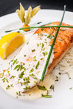 Salmon dinner with sour cream. And green vegetable Royalty Free Stock Photo