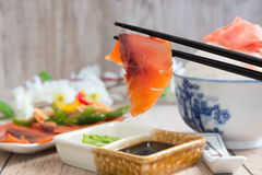 Salmon dipped in soy sauce Stock Image