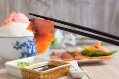 Salmon dipped in soy sauce Royalty Free Stock Image