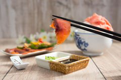 Salmon dipped in soy sauce Stock Photo