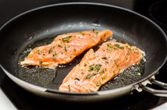 Salmon dish. Preparing salmon dish in a frying pan Stock Image