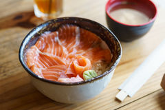 Salmon Donburi serve with miso soup on wooden table Stock Photos