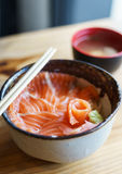 Salmon Donburi serve with miso soup on wooden table Royalty Free Stock Photos