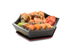 Salmon and eel sushi roll on black plate isolated on white background Royalty Free Stock Photography