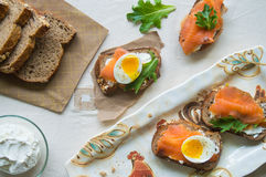 Salmon and egg bruschetta. Smoked salmon and soft boiled egg bruschetta on a wholegrain bread Stock Image