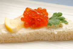 Salmon eggs over toast Royalty Free Stock Photography