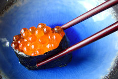 Salmon eggs sushi Stock Photography