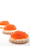 Salmon eggs on a white background Royalty Free Stock Photo