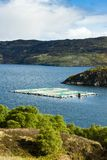 Salmon farm, Loch a Chairn Bhain, Highlands, Scotland. Outdoors, outside, exteriors, europe, western, great, britain, united, kingdom, uk, sutherland, nature royalty free stock photo