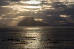 Salmon farms with dramatic sky, Faroe Islands