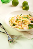 Salmon Fettuccine. With peas a creamy sauce and parsley stock image