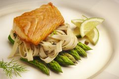 Salmon with Fettuccine and asparagus. Stock Image