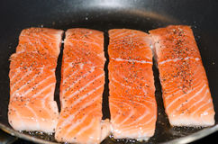Salmon fillet/tenderloin. Salmon fillet cooking in the frying pan Royalty Free Stock Image