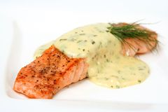 Salmon filet. Salmon with sauce bearnaise, short DOF, focus on front royalty free stock image