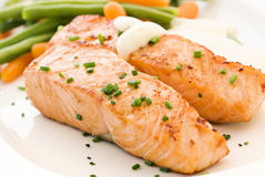 Salmon filet with Beans. And carrot royalty free stock image