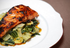 Salmon filet on bed of swiss chard and potatoes Royalty Free Stock Photography