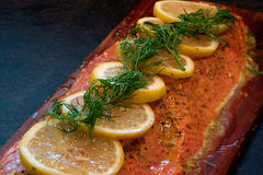 Salmon filet on cedar plank Royalty Free Stock Photo