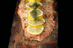 Salmon filet cooked on cedar plank Stock Photo