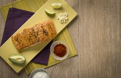 Salmon filet with ingredients royalty free stock image