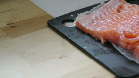 Salmon filet in kitchen stock footage