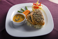 Salmon filet on rice bed Stock Image