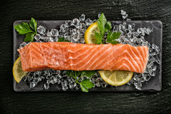 Salmon filet served on black stone Stock Photos