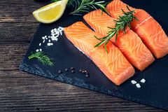 Salmon Filet Sliced On Three Parts With Lime. Stock Photo