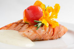 Salmon filet with white sauce and flower Stock Photos