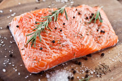 Salmon filet on a wooden carving board. Royalty Free Stock Image