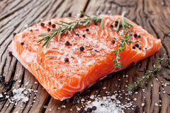 Salmon filet on a wooden carving board. Royalty Free Stock Photo