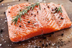 Salmon filet on a wooden carving board. Stock Image
