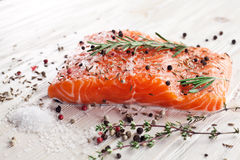 Salmon filet on a wooden carving board. Royalty Free Stock Photos