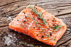 Salmon filet on a wooden carving board. Royalty Free Stock Photography