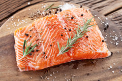 Salmon filet on a wooden carving board. Stock Images