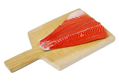Salmon Fillet. Raw salmon filet on a wooden cutting board royalty free stock images