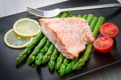 Salmon fillet on asparagus bed on dish Royalty Free Stock Photo