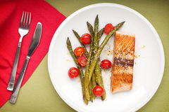 Salmon fillet with asparagus and cherry tomatoes Royalty Free Stock Image