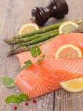 Salmon fillet with asparagus. And basil stock photography