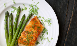 Salmon Fillet With Asparagus on White Plate Royalty Free Stock Photos