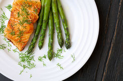 Salmon Fillet With Asparagus on White Plate Stock Image
