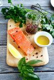 Salmon fillet with basil and pepper. Top view Stock Photo