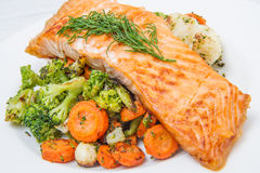 Salmon fillet on a bed of broccoli, cauliflower and carrots Stock Image